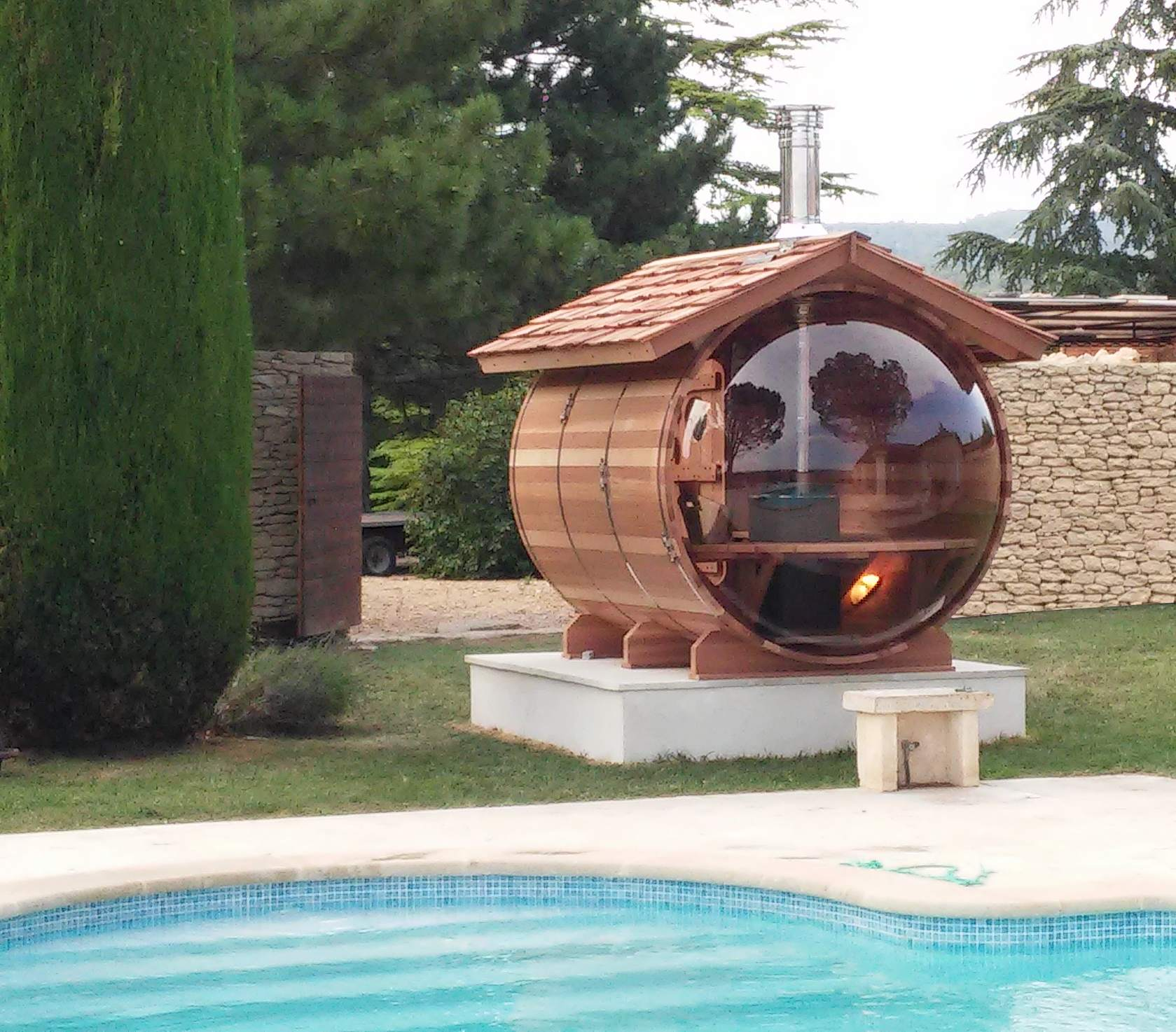 Wood-heated bubble sauna with a its roof covered with red cedar shingles