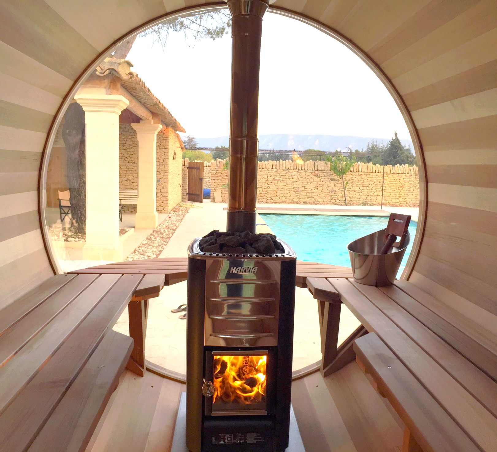 Wood-heated scenic view sauna by the pool